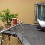 Terrasse balcon en dalles granit gris foncé et gris moyen_Valentigney